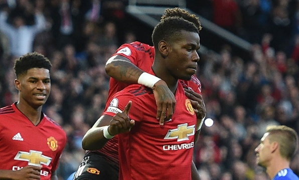 Pogba scores as Man United wins Premier League opener