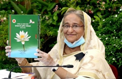 PM unveils cover of two reports