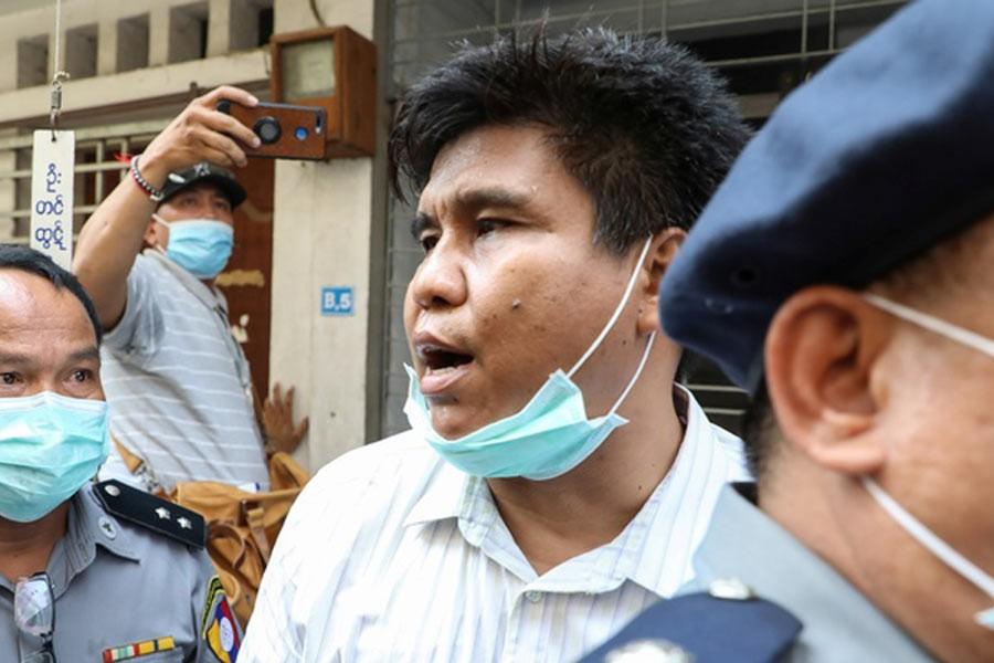 Myanmar charges journalist under terrorism law, blocks news websites