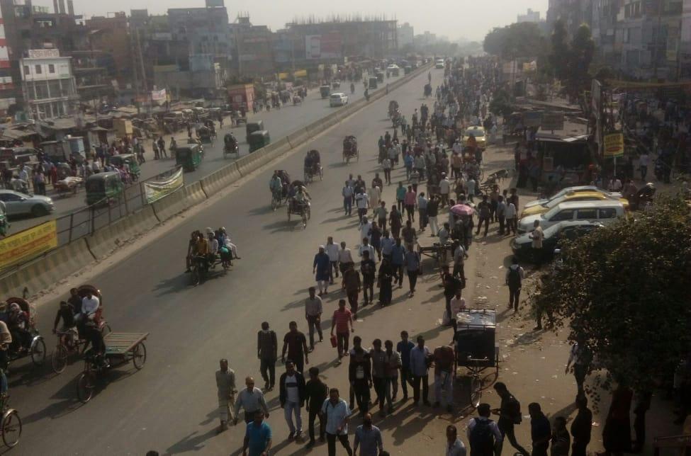 Lack of public bus, people starts walking to reach destination