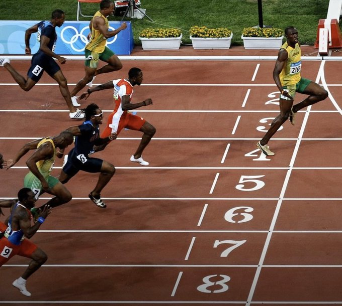 Bolt goes viral with 'social distancing' Olympic photo