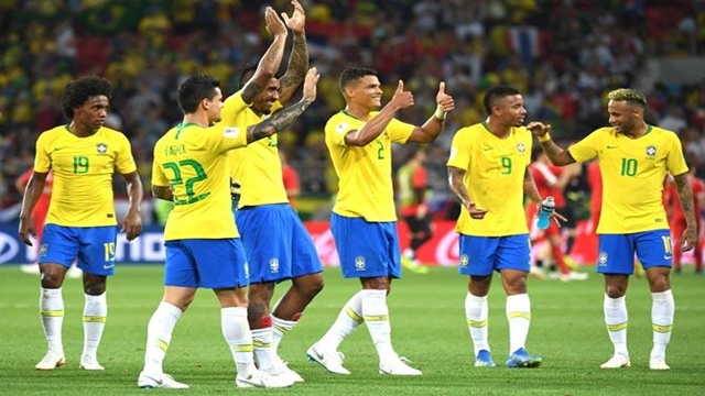 Thiago, Paulinho steer Brazil into World Cup's last 16