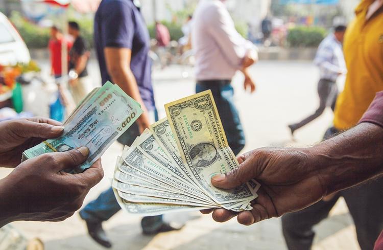 Taka strengthens against dollar
