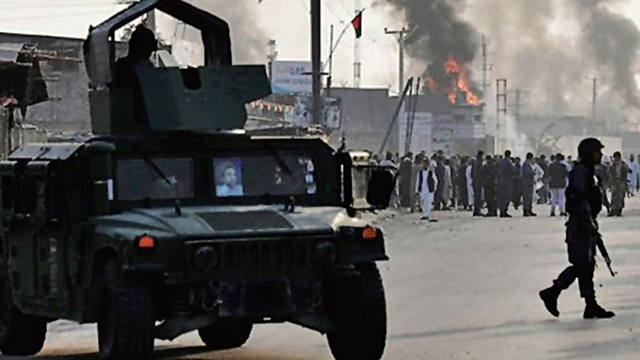 Blast kills 24 near election rally for Afghan president